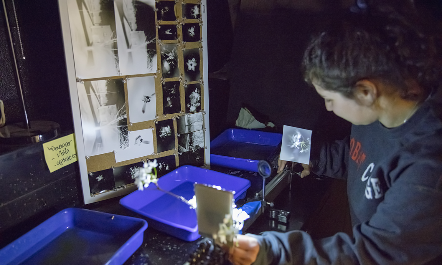 Tzipora Glaser 'X works a pinhole camera in the darkroom of Gulick Hall.