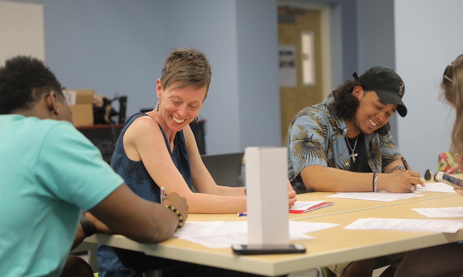 Associate Professor of Theatre Heather May reviews the mission of MOSAIC NY with new members in WIlliams Hall.