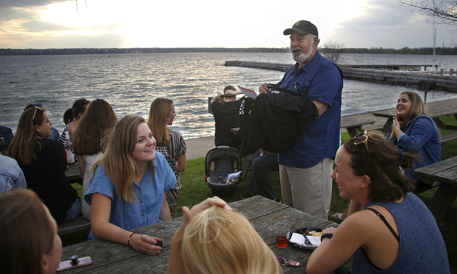 Professor of Anthropology and Sociology Jack Harris welcomes students to the Sociology Department's end of the year celebration at Seneca Lake State Park.