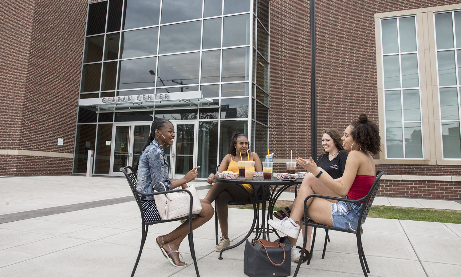 Students relax on the patio of the Gearan Center for the Performing Arts during reading days.