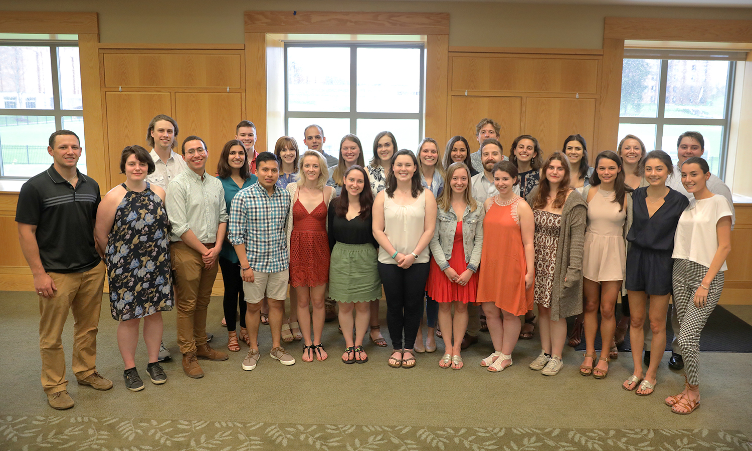Students and faculty who participated in this year's Honors program gather for a photo in the Vandervort Room.