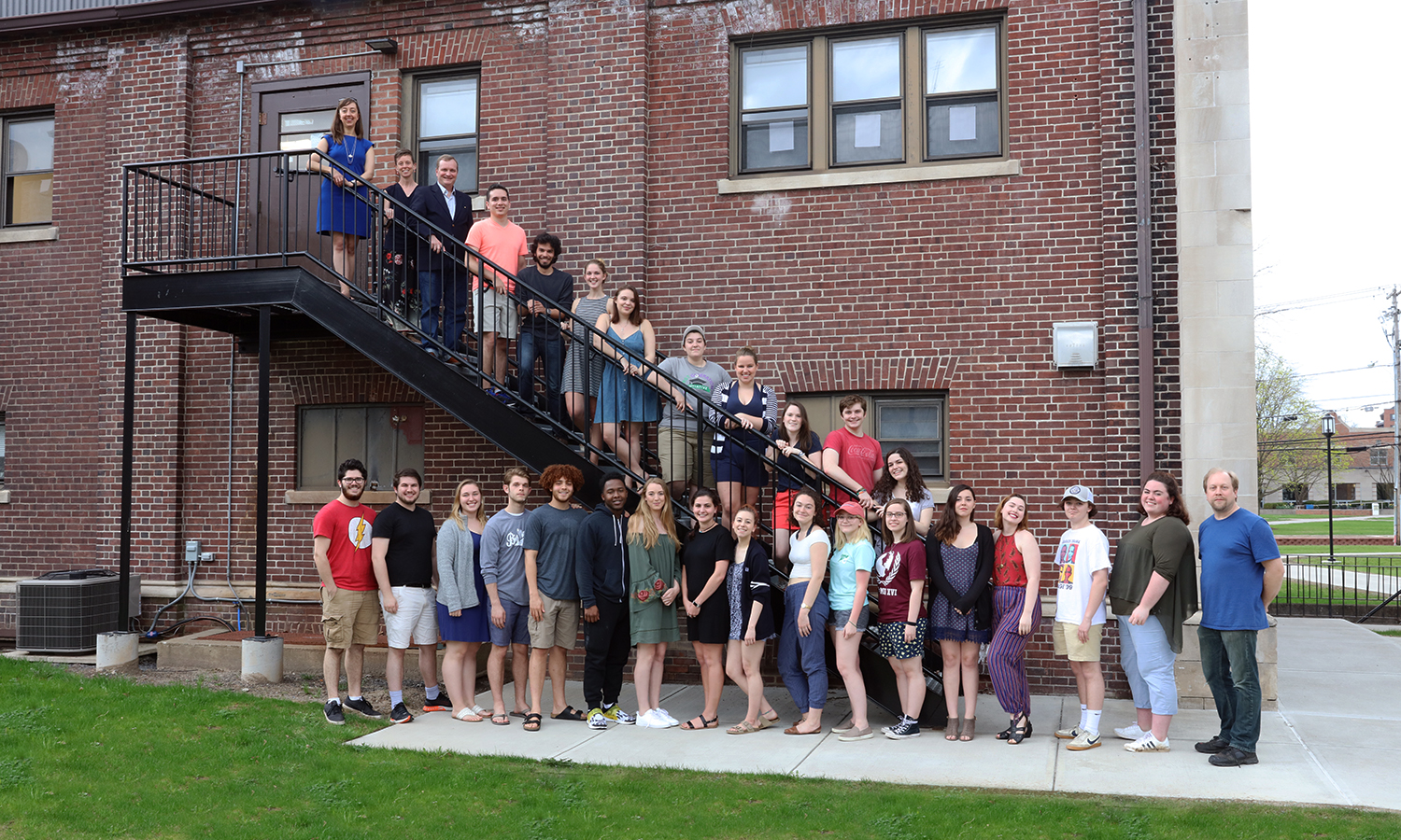 Members of the HWS Theatre Department gather for a group photo behind Williams Hall.