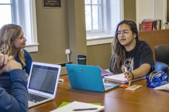 """Assistant Professor of Education Audrey Roberson facilitates a discussion with x and x during """"Second Language Acquisition."""""""