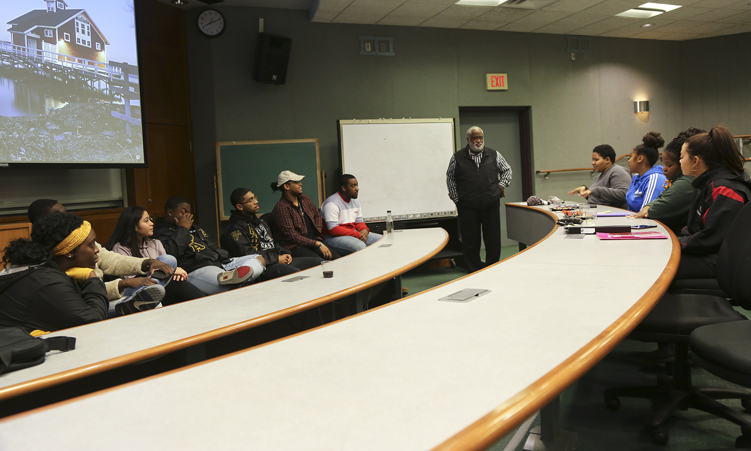 "In collaboration with the African American Men's Association, students serve on a panel on ""Personal Financing"" for an audience of Geneva high school students."