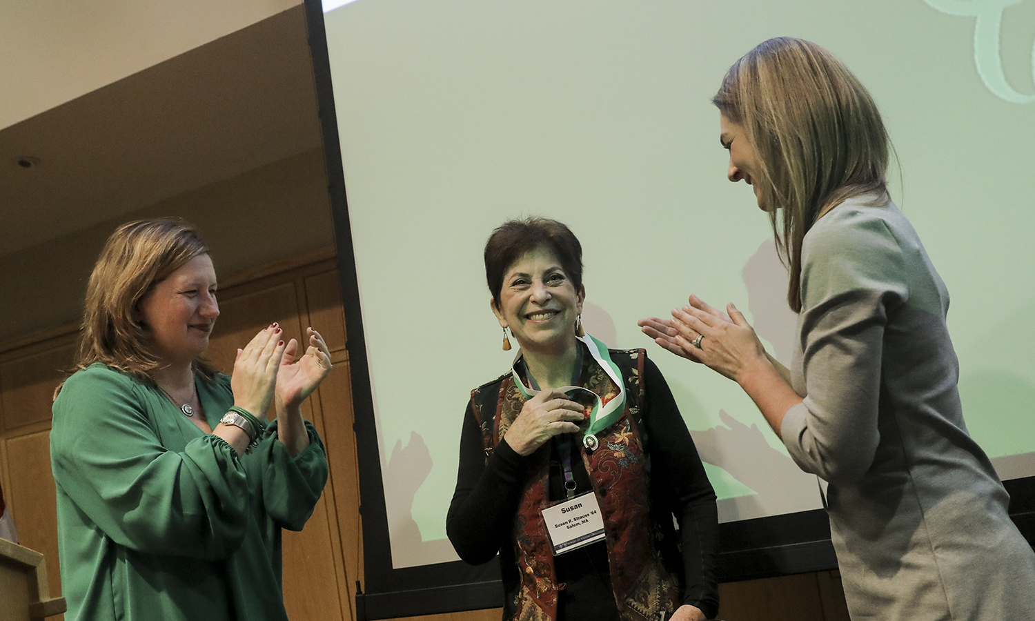 Social justice and labor activist Susan Strauss '64 accepts the William Smith Alumna Achievement Award from Alumna Association President Julie Bazan '93 and Vice President Kirra Henick-Kling Guard '08, MAT '09  during the William Smith College Founder's Day celebration on Thursday.