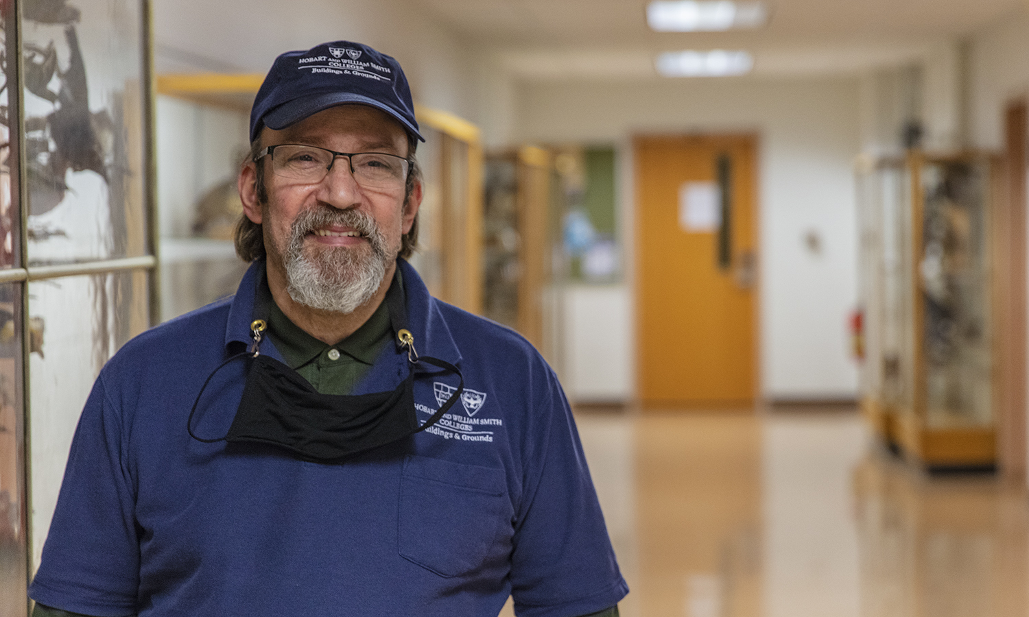 Heavy Duty Custodian Mark Cardinale poses in Eaton Hall on his last day of work. Cardinale has retired after working the night shift, primarily in the science buildings, for 33 years.