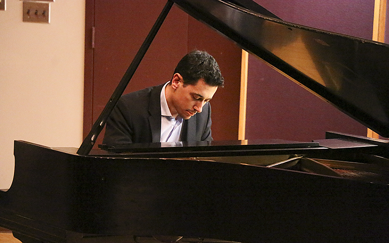 Justin Krawitz play in the Geneva Room sponsored by the Department of Music for a Piano Recital