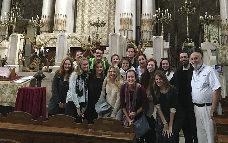 ________________________________________From: Harris, JackSent: Tuesday, November 10, 2015 12:48 PMTo: Williams, CathySubject: Rome Program Visiting the Synagogue in the Jewish GhettoHi Cathy,Attached find a photo of the Rome program students visiting the great synagogue of the Jewish Ghetto of Rome with Professor Fabio Benincasa and me.  Jews were restricted to living in the ghetto from 1555 to 1885 -- 330 years.  The synagogue was completed in 1904 and is a celebration and recognition of Jewish rights to citizenship and worship.  Of course, In 1943 the many members of the Rome Jewish community, as well as other Italian cities, were sent to and perished in Auschwitz.Hope all is well with you!Jack