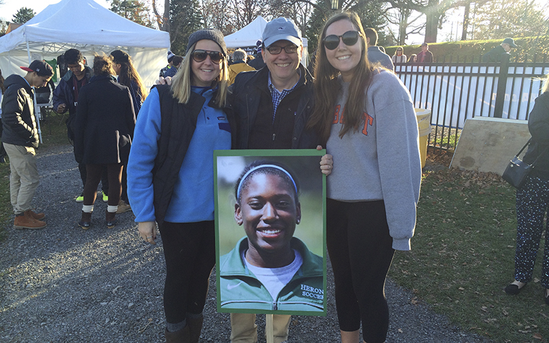 Erin casey '16 and Kathryn Busa '16 stand with mark gearan at the William smith soccer game supporting their friend Zoe Jackson Gibbson '16