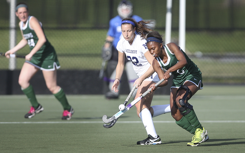 Heron's juniot Cydney Conley battles with Middlebury during the quarterfinals of the NCAA Division III Field Hockey Championship on McCooey Field Sunday.