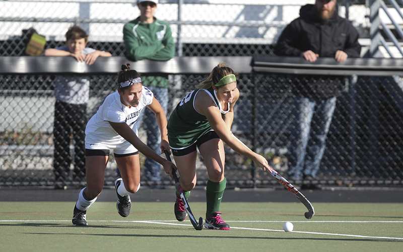 William Smiths Alexandra Frary gets around the Middlebury defense Sunday on McCooey field during the NCAA Division III Field Hockey Championship game.