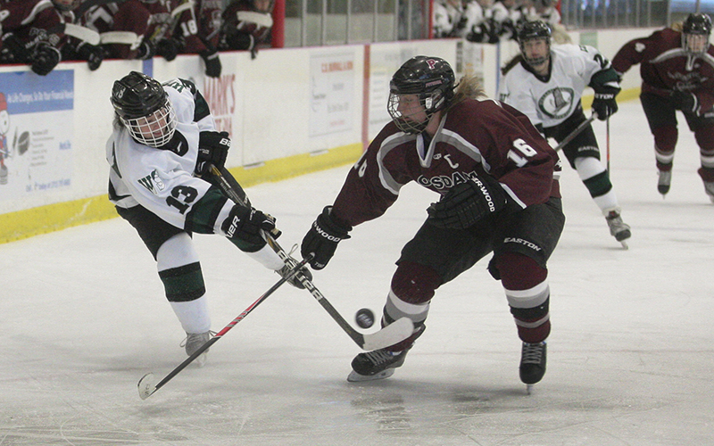 Kiley Fewster crosses the puck during Saturday nights 2-2 game against Potsdam at the Cooler.