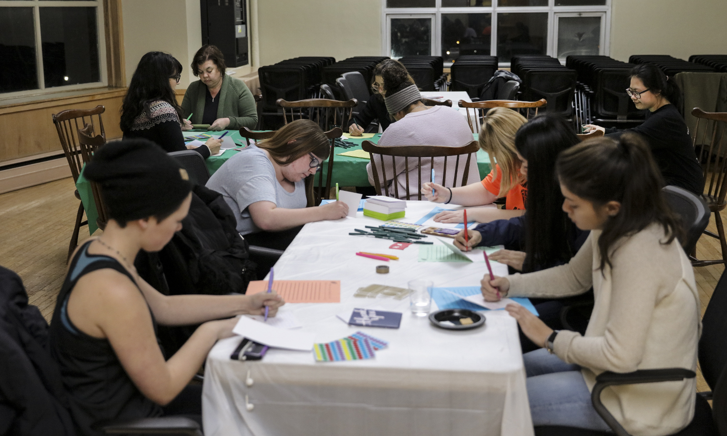 "Students write thank you notes to members of the campus community during ""Tea with the Deans"" in the Hirshon Ballroom."