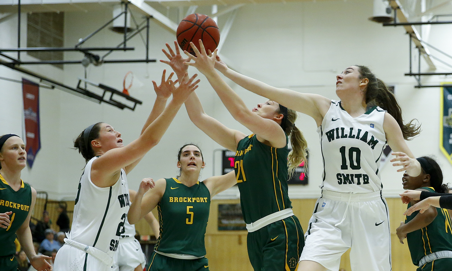 Emma Gallagher â19 and Amy Dooley â22 reach for the ball during William Smith âs 83-70 win over the College at Brockport.