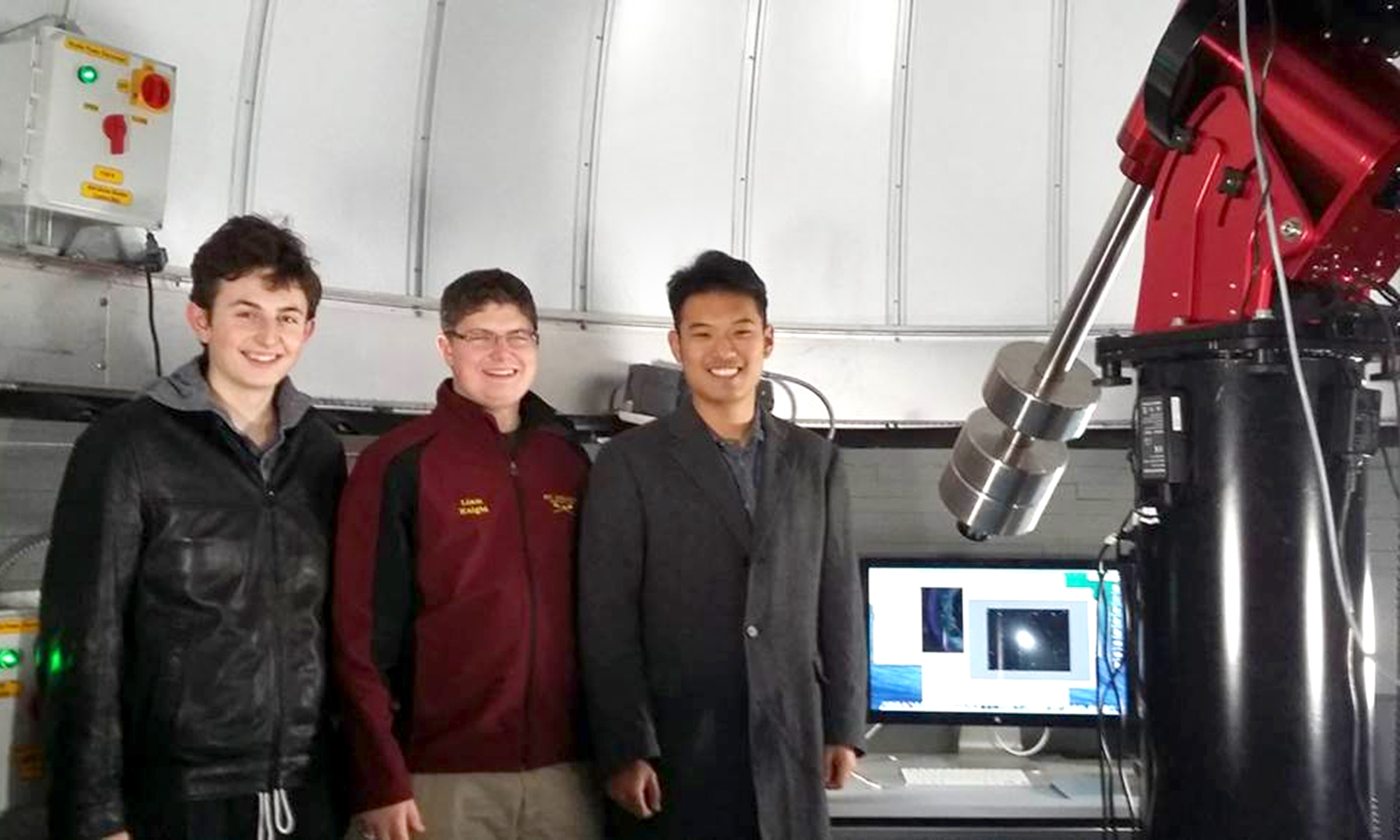 Assistant Professor of Physics Leslie Hebb captures a photo of Ben Chen 'X, Liam Knight 'X, Chris Lucore 'X while they observe the Andromeda Galaxy using the telescope's digital camera in the Richard S. Perkin Observatory.