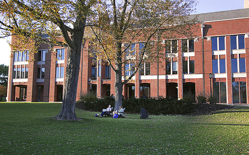 Students take advantage of the warm weather to study outside the Warren Hunting Smith Library.