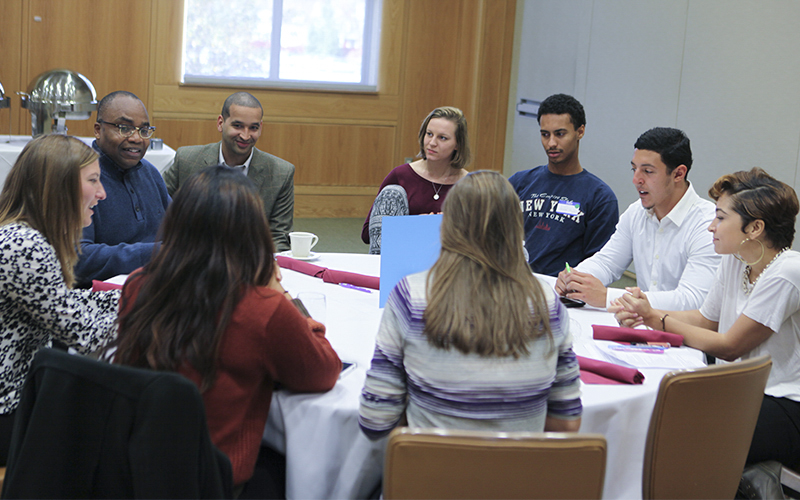Chaplain Maurice Charles and Assistant Professor of Political Science Justin Rose facilitate a small group discussion after hearing from the student storytellers at HWS Impact on Sunday afternoon.