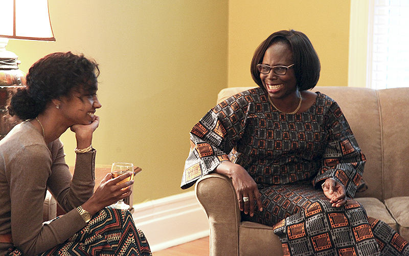 "HWS Provost and Dean of Faculty Titi Ufomata exchanges  a laugh with Solomé Rose, manager of global and community leadership programs for the Centennial Center for Leadership. Ufomata hosted faculty and staff in her home for ""Wednesday with Titi."""