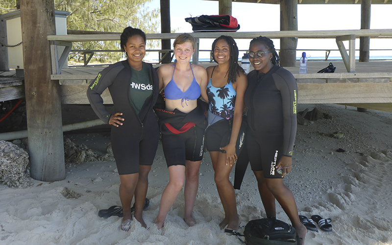 Dignauris Garcia '17, Bisiayo Fashemi '16 (Union College), Justine Monthony '17 (Union College) and Jerlin Garo '17 snap a photo before snorkeling on a trip to Heron Island. ​They are studying abroad in Queensland, Australia through a joint program with Union College.
