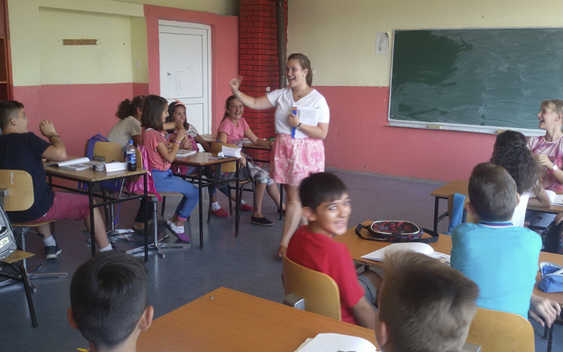 Emily Surprenant '15 teaches English to a class of students in Kosovo. Supernat is completing her Peace Corps Service in Kosovo, where she teaches English to over 300 third to ninth grade students.