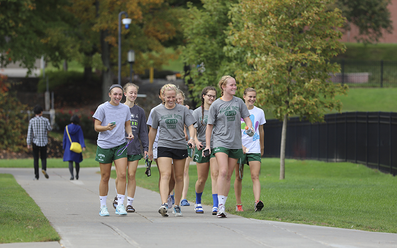 Members of the William Smith Soccer team head to lunch Monday after the morning practice.