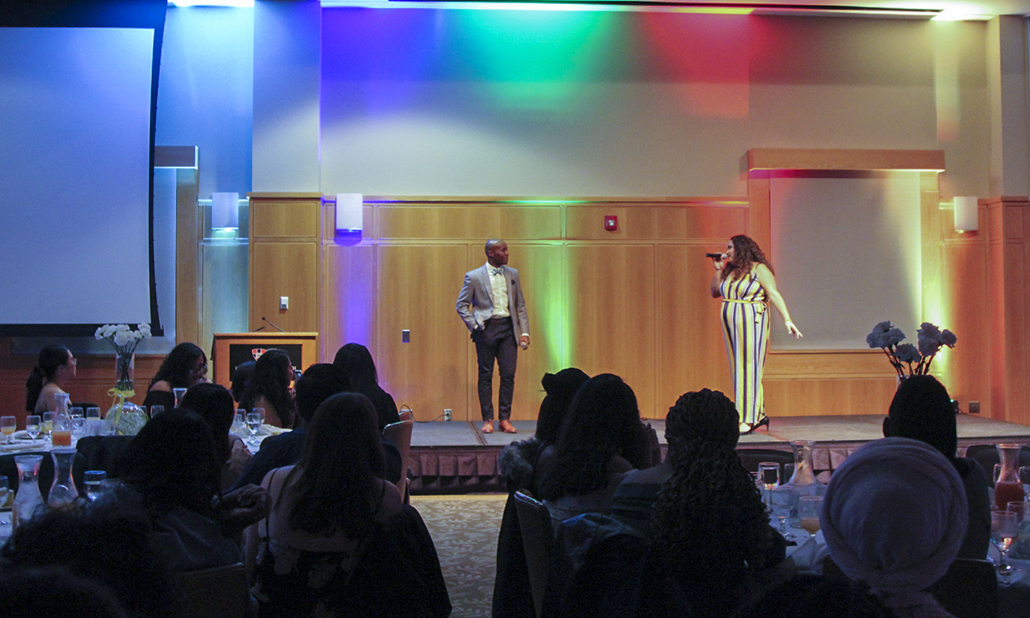 MC's at the Heritage Dinner, hosted by the Latin American Association and the LGBTQ+ Resource Center, Marcel Johnson '19 and Sheila Valiz '20 warm up the crowd.