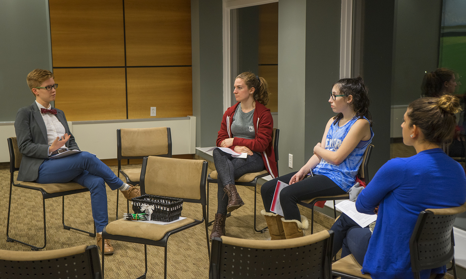 Prevention and Education Coordinator for the Office of Title IX Programs and Compliance Katie Stifler speaks with students during a session on healthy relationships as part of the Red Flag Campaign and Dating Violence Awareness Month.