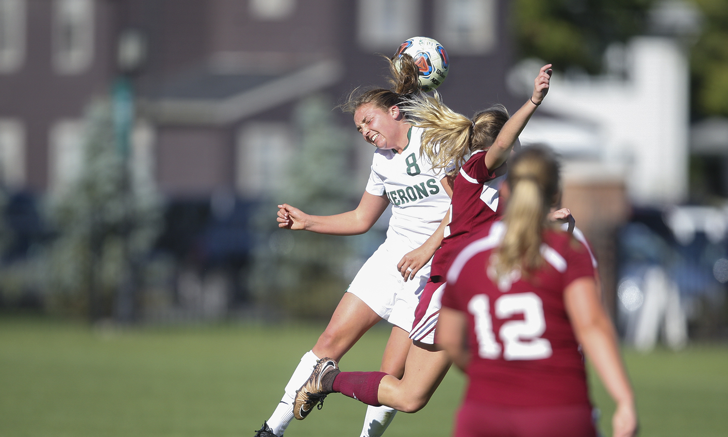 Elizabeth Moore 'X goes head to head with a Vassar defender during the Heron's 4-0  Liberty League victory at home on Saturday.