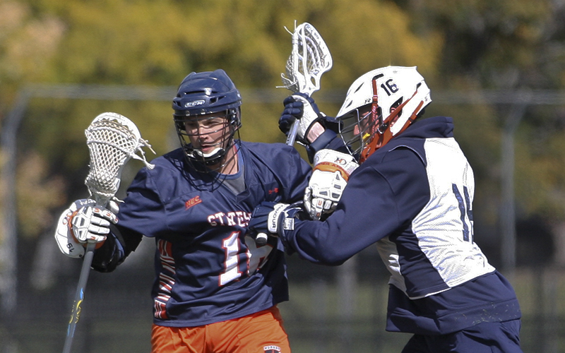 Hobart Alum Jamie Giles '04 takes a hit during the Annual Hobart Alumni Lacrosse weekend game. Over 35 alums returned to play the current team in a friendly game Saturday on the Boz.