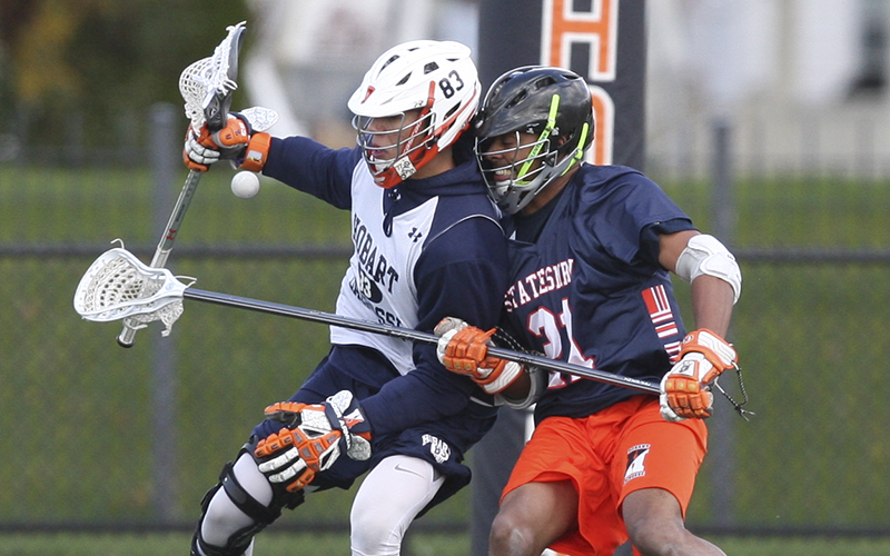 Marcus Craigwell '09 gets the ball loose from Frank Brown '16 as the Hobart Alums play the Current Lacrosse team saturday on Boswell Field.