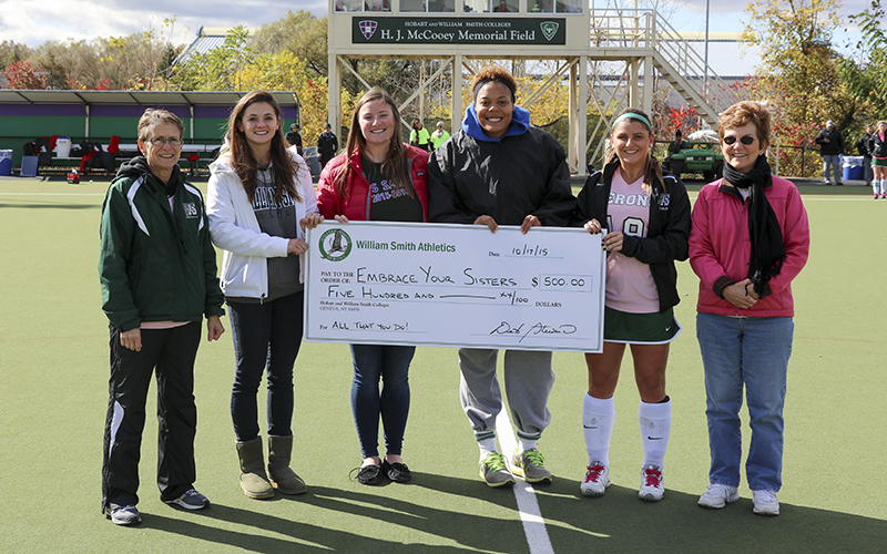 William Smith Athletics presented a check to Embrace Your Sisters for $500 before Saturdays Field Hockey Game.