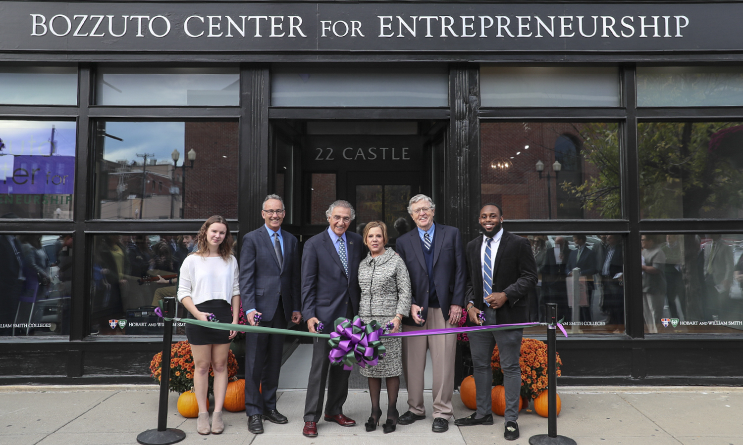 Chloe Elmer '20, Professor of Economics Thomas Drennen, Chair of the Board of Trustees Thomas S. Bozzuto '68 L.H.D. '18, Interim President Patrick A. McGuire L.H.D. '12and Al Smith '19 pose for a photo during the ribbon cutting ceremony as part of the dedication of the new Bozzuto Center for Entrepreneurship in downtown Geneva, N.Y.