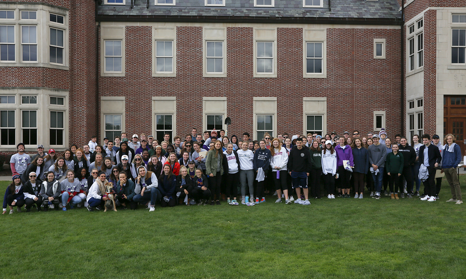 Students participating in the annual fall Day of Service gather for a group photo in front of Stern Hall.