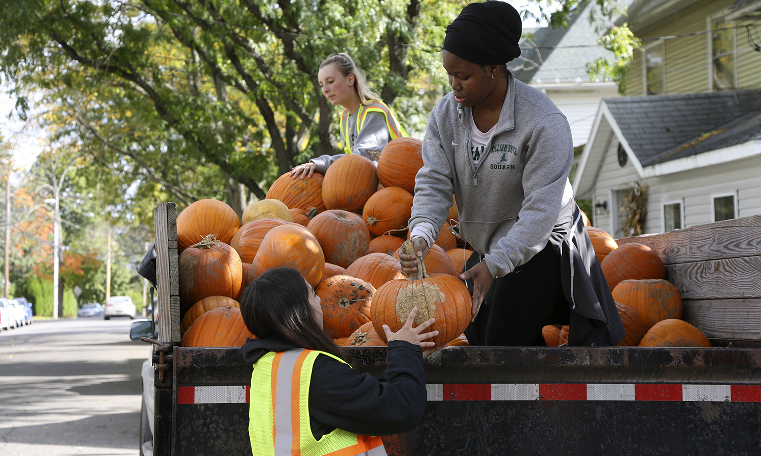 Djenebo Ballo '21 helps unload pumpkins in preparation for the 6th Annual Hildreth Hill Pumpkin Roll in Geneva, N.Y.