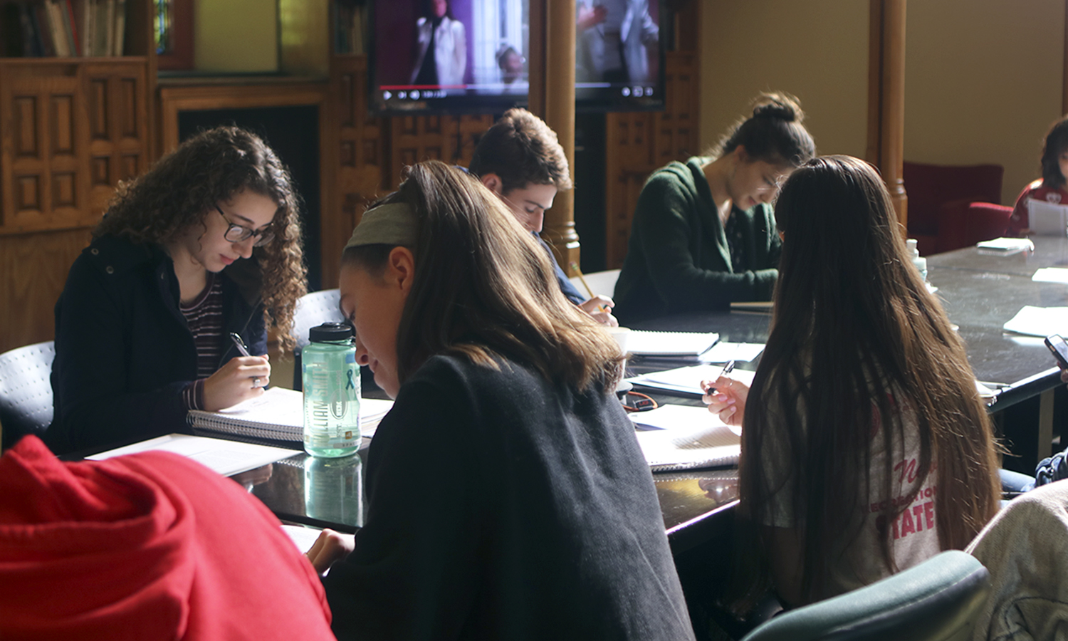 Lilly Shea '20 works on a writing assignment as part of a creative non-fiction workshop led by graduate students from the Creative Writing Program at University of Iowa .
