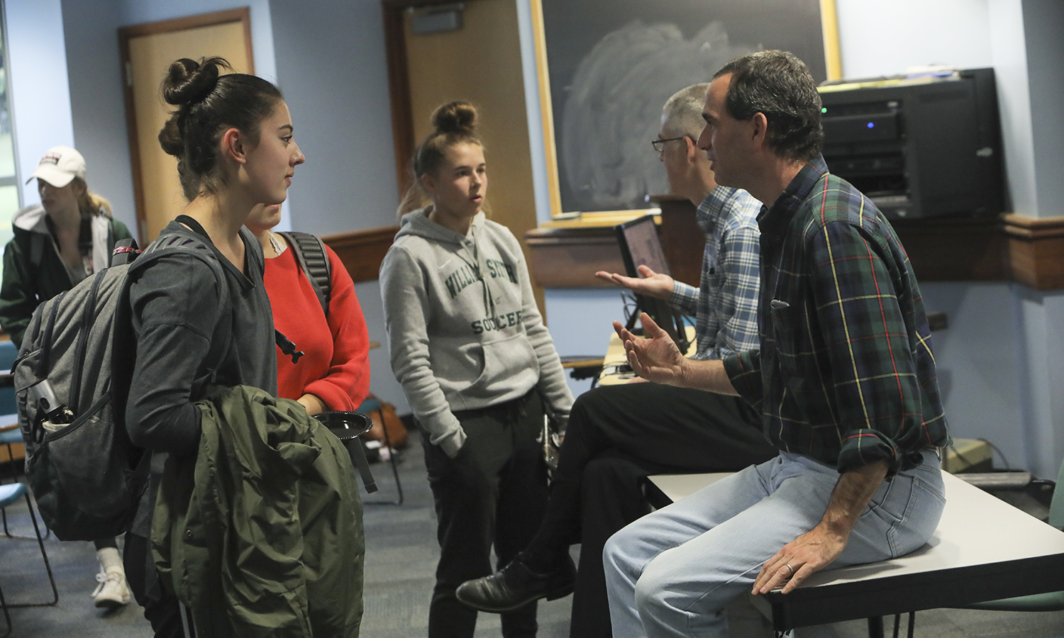 Associate Professor of Chemistry Justin Miller and Associate Director of Health Professions Counseling and Fellowship Advising Scott MacPhail speak to students about the Collegesâ pre-health program during an information session in Napier Hall.