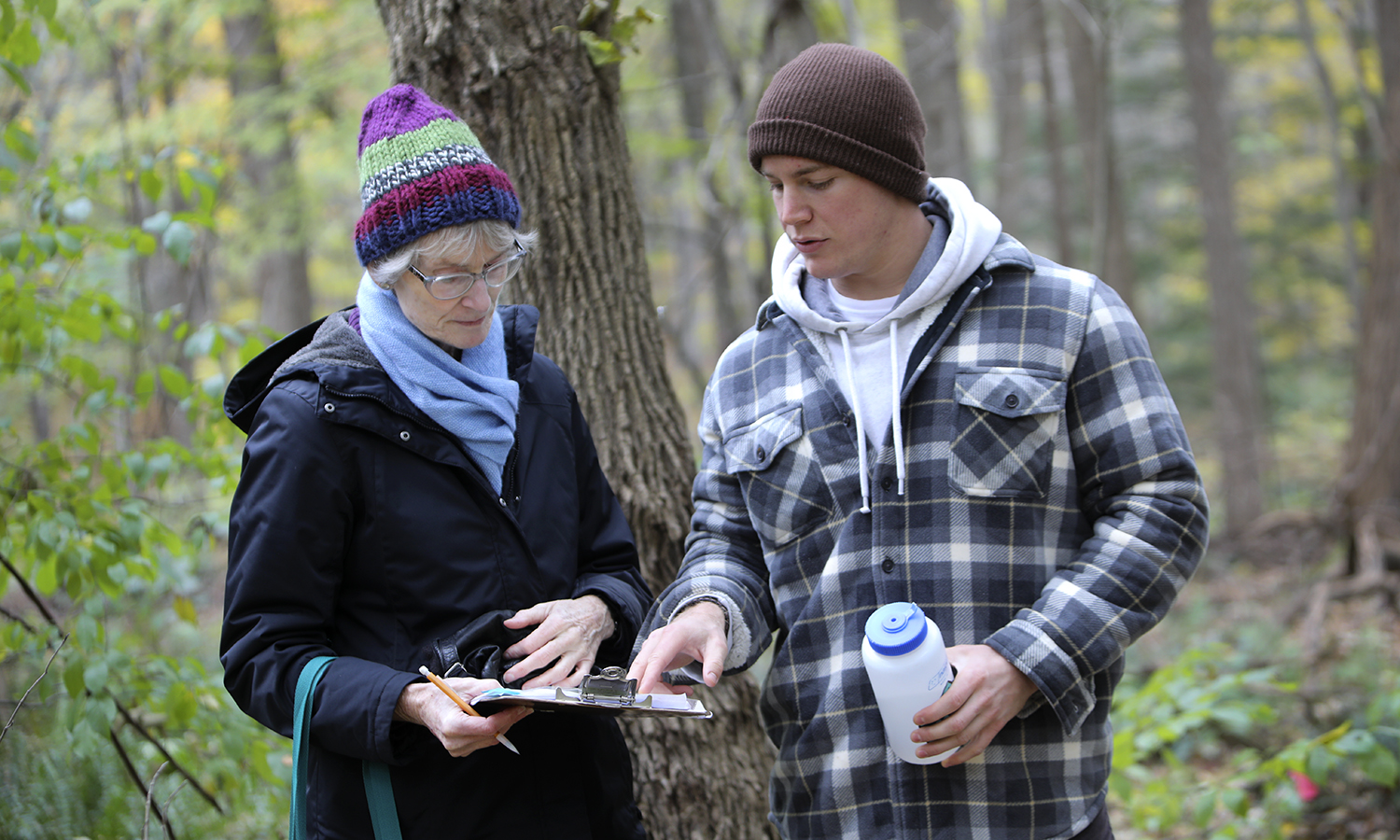 At the Kashong Creek Conservation Area, Professor of Biology Beth Newell and Parke Schweiter '19 record data as part of Schweiter's independent study on the impact of the Emerald Ash Borer on forests in the Finger Lakes region.