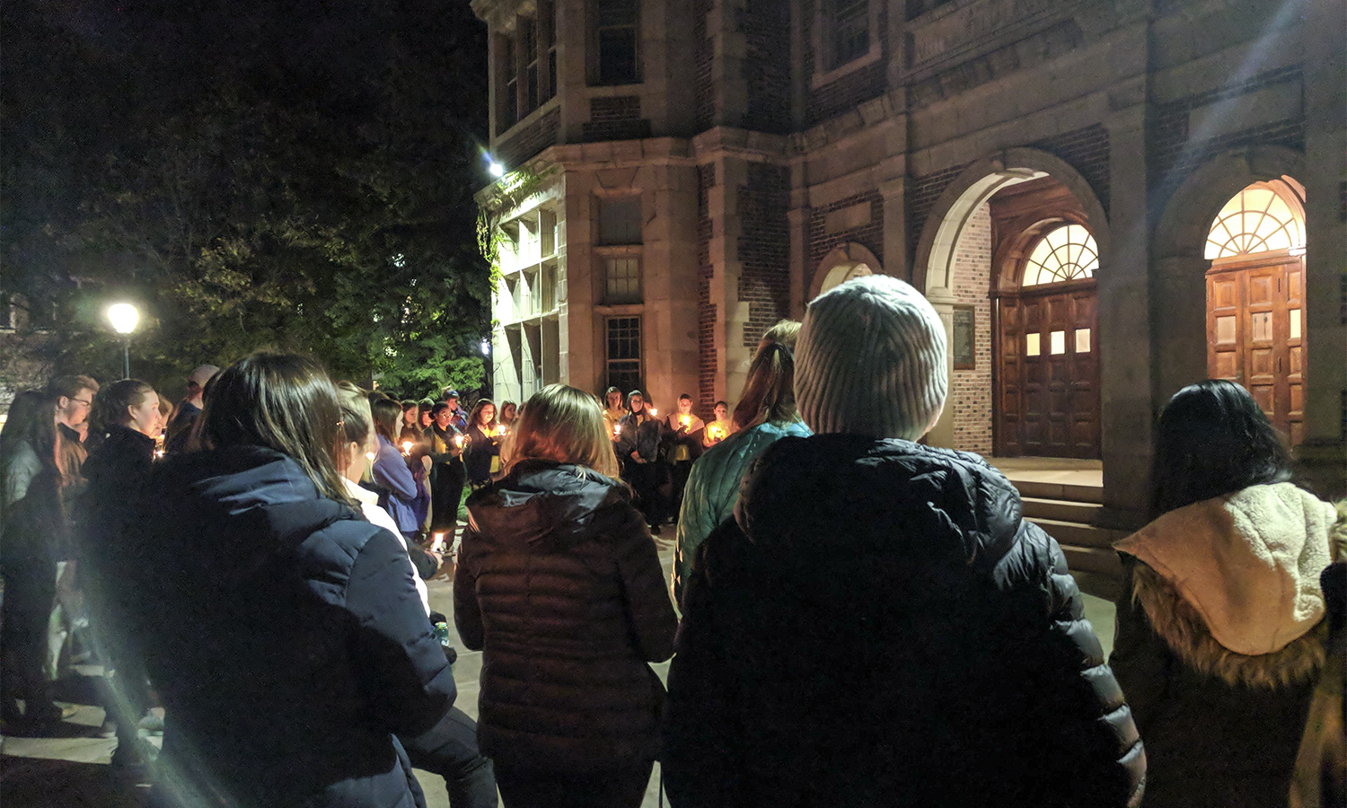 Students, faculty, and staff gather during Take Back the Night on the Steps of Coxe Hall. The event was hosted by the WS Women's Collective.