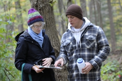 At the Kashong Creek Conservation Area, Professor of Biology Beth Newell and Parke Schweiter â19 record data as part of Schweiterâs independent study on the impact of the Emerald Ash Borer on forests in the Finger Lakes region.