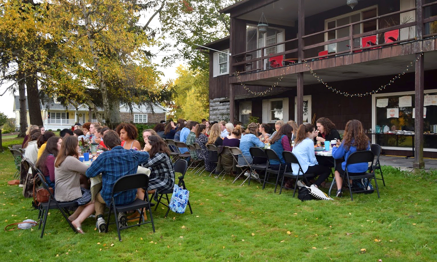 Students, faculty and staff gather for the Harvest Dinner event at the HWS Fribolin Farm on Sunday. The dinner featured local foods and live music in celebration of HWS Food Week.