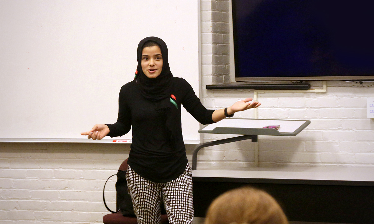 "Zahra Arabzada '18 discusses the Muslin travel ban during ""Stop The Hate: Countering Misconceptions about Muslims"" in Demarest Hall."