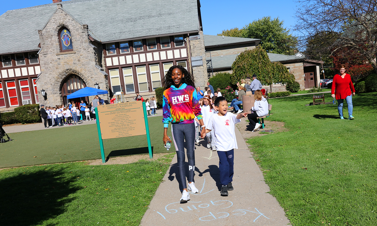 Canieshia Phillips ' helps a student during the Walk-a-Thon at St. Stephens elementary.