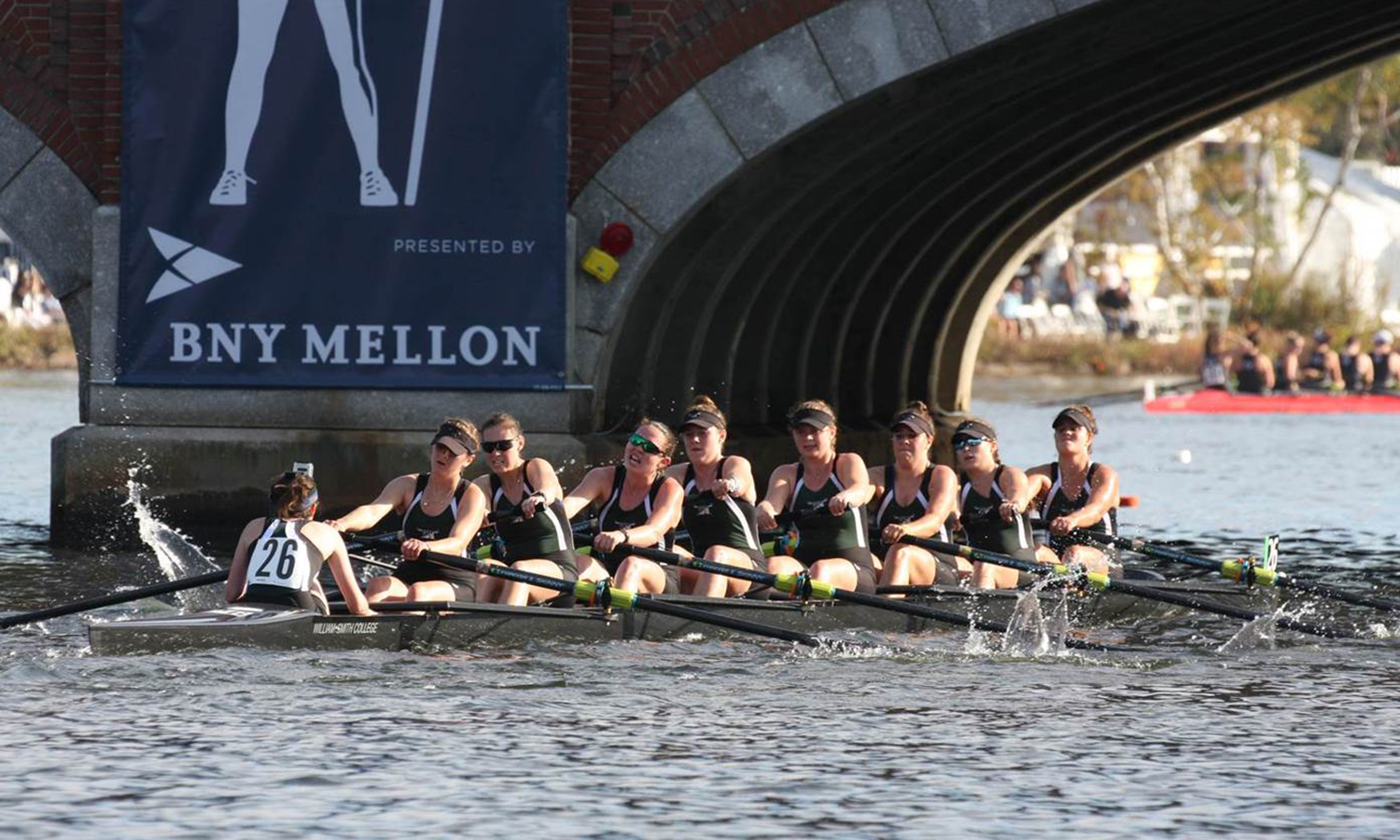 The William Smith rowing team competes in the Head of the Charles Regatta, finishing 12th of 26 teams.