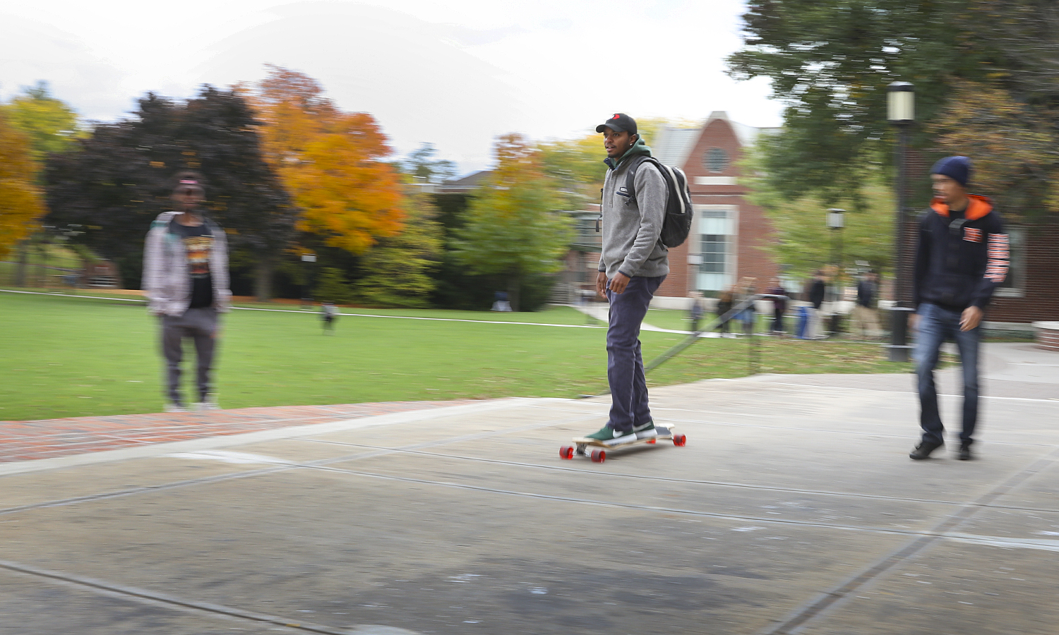 Stephen Rodgers '18 heads to his class aboard his new skateboard on Wednesday afternoon.