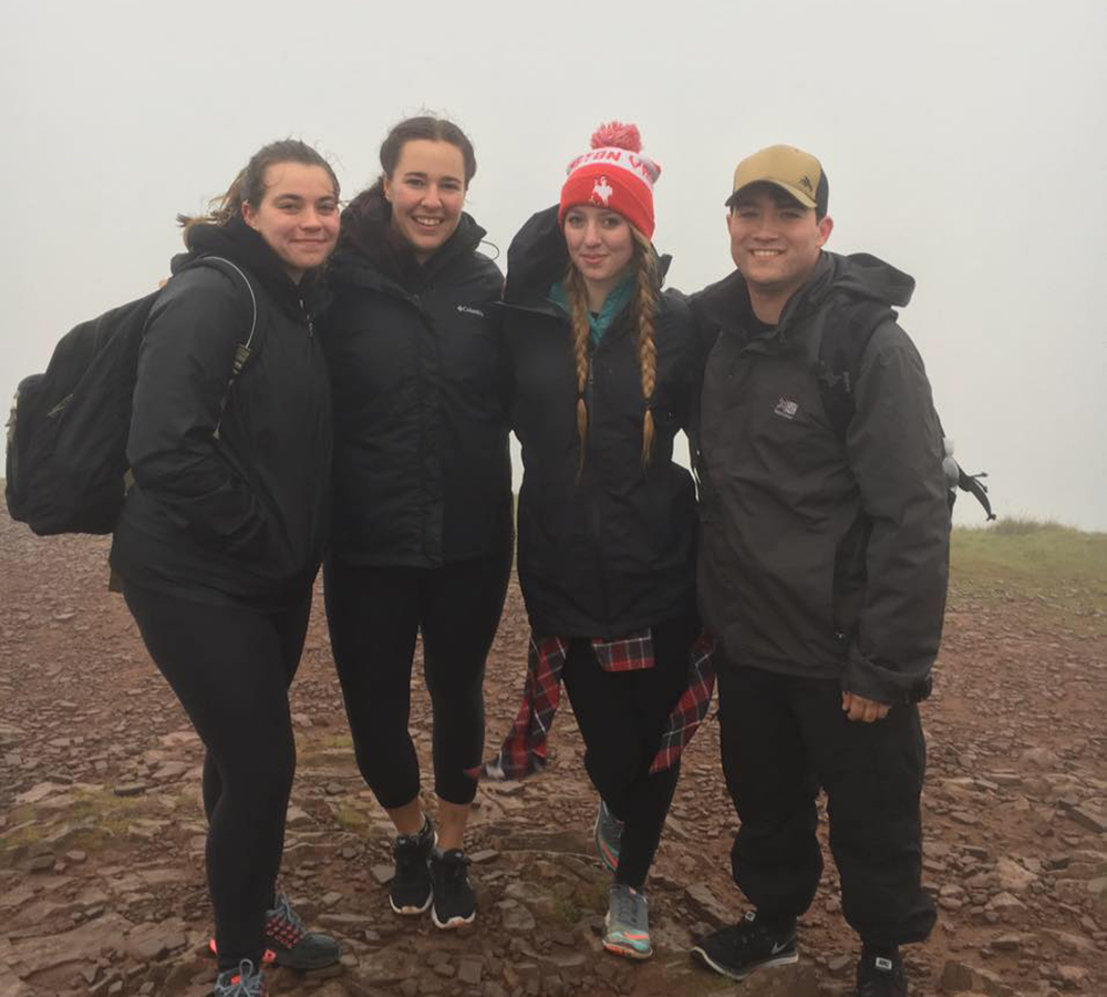 Kylie Wyskochil, Elizabeth Warren, Anika Hanson and Tyler Crowder pose for a photo at the top of the Brecon Beacons in South Wales.