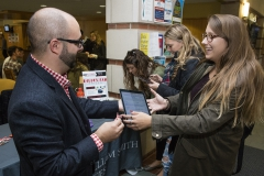 As part of Alcohol Awareness week, Kaitlyn Standfest '18 completes a two-question survey on her perception of alcohol with Director of Residential Education and Associate Dean of Students Brandon Barile. Upon completion, students are presented with facts about social norms and how their perceptions compare to the rest of the student body.