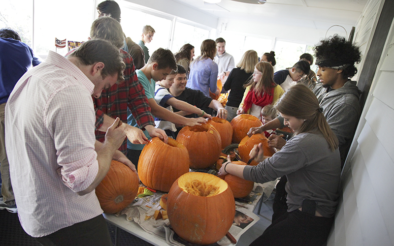 The Gearans host an open house where students and community members carve pumpkins and enjoy cider and treats.