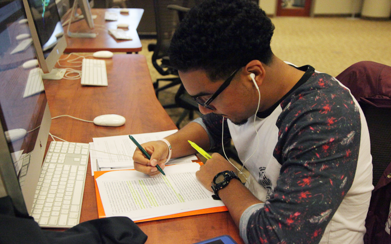 Senior, Neil Jaico revises his essays in the library