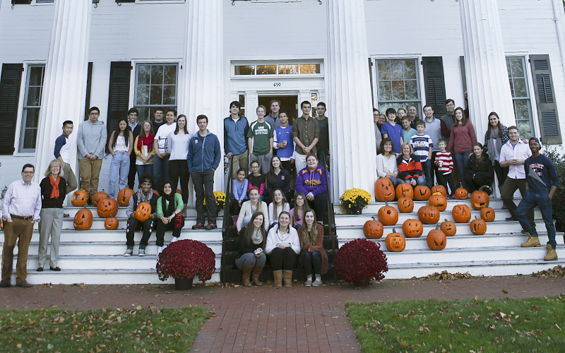 Pumpkin Carving at the Presidents House. Geneva grade students and HWS students unite for an evening full of lights, laughter, and plenty of good food.