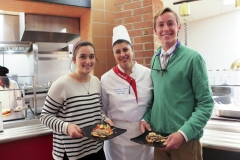 Russian Global Chef, Liliia Shkileva, serves Danielle Moyer '18 and Cam Williams '19 her favorite Russian dishes she prepared for HWS students in Saga on Wednesday night.